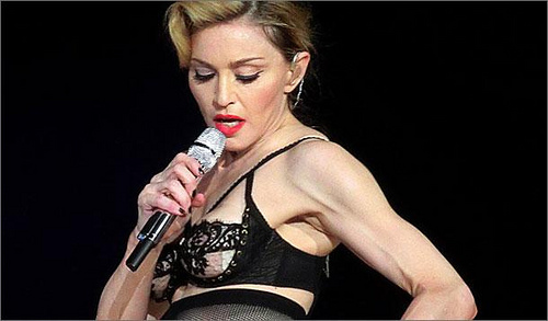 Material Girl Angers French Political Party and Flashes Nipple at Concert